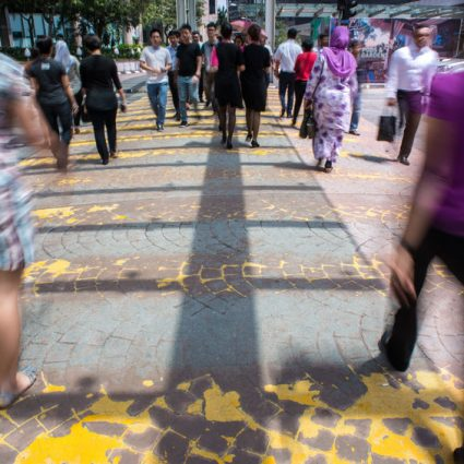 Motion Blur - People crossing the road. Blurry effect to illustr